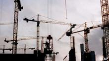 Cranes surround a construction worker at Berlin's Potsdamer Platz in December of 1996. The historic plaza was undergoing extensive reconstruction and development.