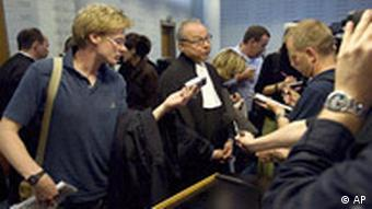 Axel Hagedorn, center, a lawyer for the victims, talks to journalists at The Hague District Court in The Hague, Netherlands, Thursday, July 10, 2008