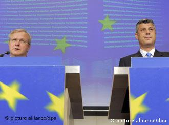 European Union enlargement commissioner Olli Rehn, left, and Kosovo Prime Minister Hashim Thaci
