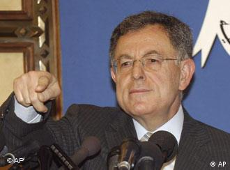 Lebanon's Prime Minister Fuad Saniora gestures during a press conference at the Presidential Palace in suburban Baabda, Lebanon, Friday, July 11, 2008. Saniora formed Friday a national unity Cabinet in which Hezbollah and its opposition allies have veto power over government decisions. (AP Photo/Mahmoud Tawil)