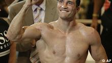 Ukrainian boxer Vladimir Klitschko, celebrates after he beat his challenger U.S. Tony Thompson, unseen, after their world heavyweight title fight in Hamburg, Germany on Saturday, July 12, 2008. Klitschko defended his IBF/WBO and IBO World Championship title with a knock out in the 11th round. (AP Photo/Axel Heimken)