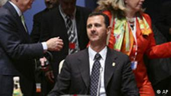 Syrian President Bashar Assad, center, waits for the start of a Mediterranean Summit round table meeting at the Grand Palais in Paris, Sunday July 13, 2008.