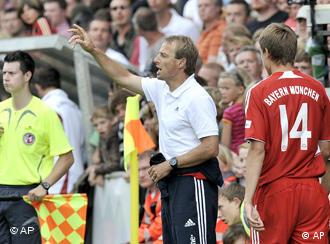 New Bayern head coach Juergen Klinsmann, center, reacts during a friendly soccer match between SV Lippstadt and Bayern Munich in Lippstadt, Germany, Sunday, July 13, 2008.