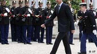 Syrian President Bachar Assad, center, arrives at the Elysee Palace prior to a meeting with French President Nicolas Sarkozy in Paris, Saturday, July 12, 2008. (AP Photo/Jacques Brinon)