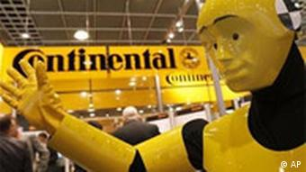 A crash test dummy at a Continental stand at a car show