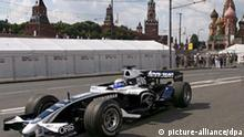 AT&T Williams driver Nico Rosberg, from Germany, performs in front of St. Basil's Cathedral during Moscow City Racing in Moscow, Russia, 13 July 2008. During show Moscow City Racing by the direction around Moscow's Kremlin in downtown of Russia capital drive the real bolides of F-1 by the AT&T Williams team and Red Bull Racing team and more them fifty cars from the other class of car racing. EPA/SERGEI ILNITSKY +++(c) dpa - Report+++ pixel