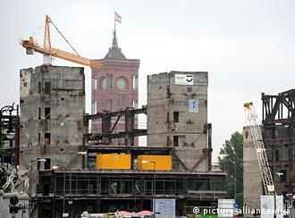Two concrete towers that were part of the palace of the republic in front of Berlin's city hall tower