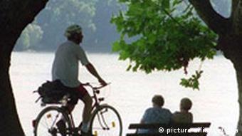 Man biking along the Rhine River