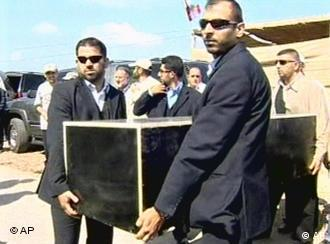 Hezbollah members carrying a black coffin