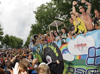 Techno fans celebrate during the Love Parade 2008 music festival in Dortmund