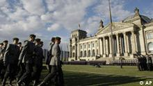 German soldiers arrive at the Reichstag to take part in an oath taking of 500 soldiers of the German Bundeswehr in front of the Reichstag in Berlin on July 20, 2008, commemorating the 64th anniversary of the failed assault on Nazi leader Adolf Hitler from July 20, 1944. (AP Photo/Herbert Knosowski)