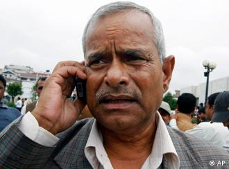 Nepali Congress party presidential candidate Ram Baran Yadav, 61, talks on phone at the International Convention Center in Katmandu, Nepal, Saturday, July 19, 2008. Nepal's governing assembly began voting Saturday for the new republic's first president, a three-way race that includes a 72-year-old anti-monarchist who escaped the death penalty after being convicted of bombing Parliament more than two decades ago. (AP Photo/Binod Joshi)