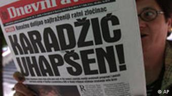 A Bosnian woman reads the Bosnian daily newspaper, headlined Karadzic arrested and showing a photograph of Bosnian Serb leader Radovan Karadzic on the front page, in Sarajevo, Bosnia, on Tuesday, July 22, 2008.