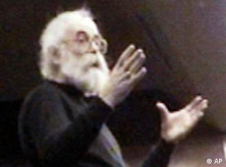 Karadzic with white hair and a long white beard