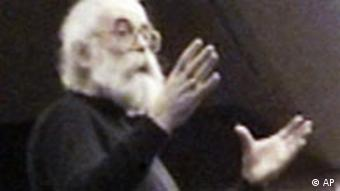Undated photo of Radovan Karadzic with glasses, long white hair and a beard