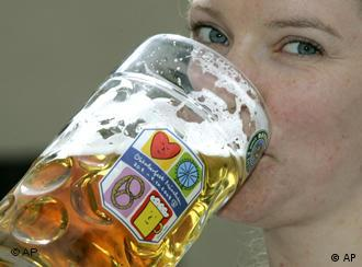 Model Yvonne takes a sip from a beer glass adorned with the logo of the Oktoberfest 2008