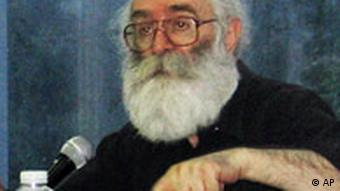 Karadzic with glasses, long white hair and a beard