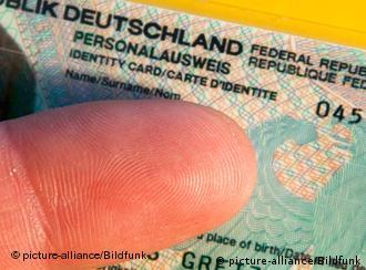 Thumb seen over ID card