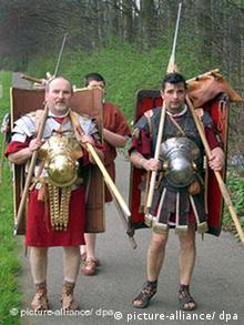 People dressed as Roman legionaires