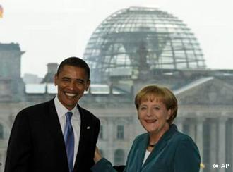 Barack Obama is welcomed by German Chancellor Angela Merkel in the chancellery in Berlin