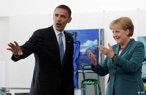 Democratic presidential candidate Sen. Barack Obama, D-Ill., left, waves to the media as he greets with German Chancellor Angela Merkel in Berlin, Thursday, July 24, 2008.