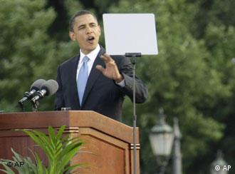 U.S. Democratic presidential candidate Sen. Barack Obama waves to the crowd as he delivers a speech at the victory column in Berlin Thursday, July 24, 2008.