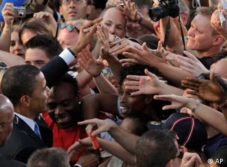 Masses of hands reaching out to Obama