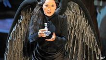Die Japanerin Mihoko Fujimura singt als Kundry am Mittwoch, 16. Juli 2008, waehrend einer Probe zur Oper Parsifal im Festspielhaus in Bayreuth. Mit der Neuinszenierung werden die diesjaehrigen Wagner-Festspiele am 25. Juli 2008 eroeffnet. Inszeniert wurde das Werk von Stefan Herheim. Die musikalische Leitung hat Daniele Gatti. Das Buehnenbild entwarf Heike Scheele. (AP Photo/Eckehard Schulz) --- Japanese Mihoko Fujimura sings as Kundry during a rehearsal of the opera Parsifal by Richard Wagner in the festival opera house in Bayreuth, southern Germany, Wednesday, July 16, 2008. The opera Parsifal is the start of this year's Wagner festival on July 25, 2008. This new production is directed by Norwegian Stefan Herheim and conducted by Italian Daniele Gatti. (AP Photo/Eckehard Schulz)