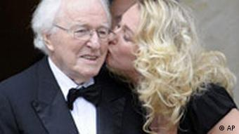 Katharina Wagner kisses her father on the cheek