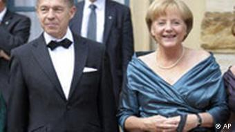 German Chancellor Angela Merkel and her husband Joachim Sauer pose prior to the Bayreuth Festival opening
