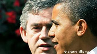Barack Obama (R) walks with British Prime Minister Gordon Brown