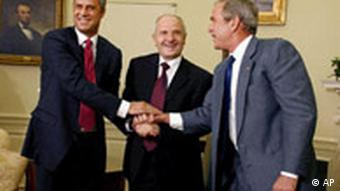 Kosova's President Fatmir Sejdiu, center, and Prime Minister Hashim Thaci, left, shake hands with US President George W. Bush