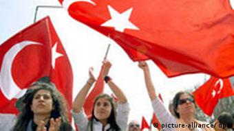 Female protestors wave Turkish flags during an anti-government protest