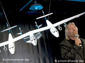 Richard Branson presents a model of the Space Ship Two and its mother ship, the White Knight Two