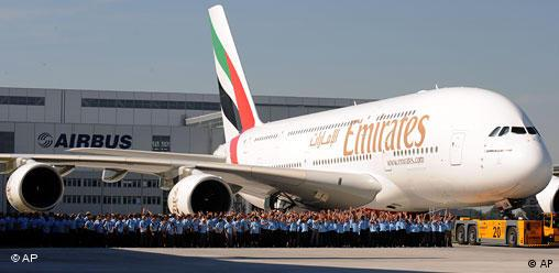 Workers of Airbus accompany the first Airbus A380 plane for the Emirates airline