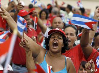 A crowd of people in Cuba with Cuban flags