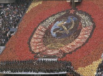 Massed rows of 3,500 card-bearers from the coat of arms of the Soviet Union with the hammer and sickle and a red star at the top during the opening ceremonies of the 1980 Moscow Summer Olympic Games in Lenin Stadium Saturday, July 19, 1980.