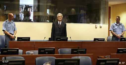 Radovan Karadzic standing in the ICC courtroom