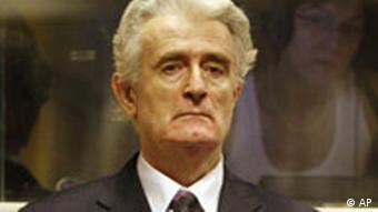 Former Bosnian Serb leader Radovan Karadzic stands in the courtroom during his initial appearance at the U.N.'s Yugoslav war crimes tribunal in The Hague