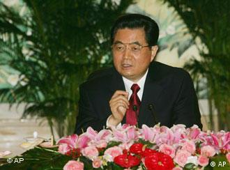 Chinese President Hu Jintao speaks during a group interview with journalists in Beijing Friday, Aug. 1, 2008. (AP Photo/Rafael Wober)
