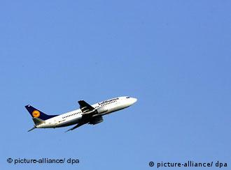 A Lufthansa plane during take off seen against a blue sky