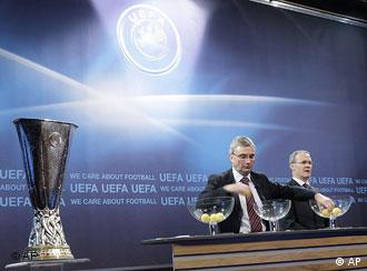 UEFA General Secretary David Taylor, left, next to Giorgio Marchetti, right, UEFA Director of professional football, removes the balls containing the names of the soccer clubs, during the drawing of the matches for the UEFA Cup 2008/09 second qualifying round, at the UEFA Headquarters in Nyon, Switzerland, Friday, Aug. 1, 2008.