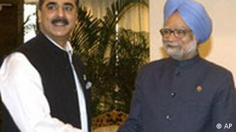 Indian Prime Minister Manmohan Singh, right, shakes hands with Pakistan's Prime Minister Yousuf Raza Gilani before a bilateral meeting on the sidelines of the 15th SAARC Summit in Colombo, Sri Lanka, Saturday, Aug. 2, 2008. Accusations that Pakistan helped a militant group bomb India's embassy in Afghanistan cast a cloud Friday over a South Asian summit aimed at fostering regional cooperation in the fight against terror. (AP Photo/Gurinder Osan)