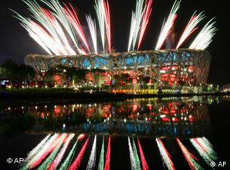 Fireworks light up the National Stadium during the rehearsal for the opening ceremony of the Beijing Olympics