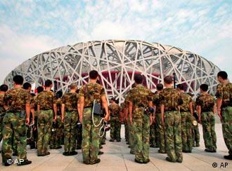 Chinese Soldiers are deployed outside Beijing's National Stadium