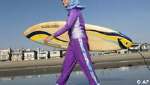 ** ADVANCE MONDAY, FEB. 19 ** Sama Wareh walks along the sand dressed in swim wear designed for Muslim women in Newport Beach, Calif., Thursday, Feb. 15, 2007. Muslim girls and women are increasingly participating in athletic activities, especially as second and third generation children of immigrants grow up surrounded by American influences. But doing so requires them to overcome a seemingly large obstacle: Islam's traditional emphasis on modest dress. (AP Photo/Chris Carlson)