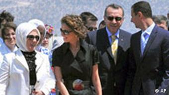 Syrian President Bashar Assad, right, and his wife Asma Assad, second left, are seen with Turkish Prime Minister Recep Tayyip Erdogan, second right, and his wife Emine Erdogan, after their arrival in the Aegean Turkish resort of Bodrum, Turkey, Tuesday, Aug. 5, 2008. The Turkish and Syrian leaders are scheduled to hold talks in the Aegean resort of Bodrum on Tuesday. (AP Photo)