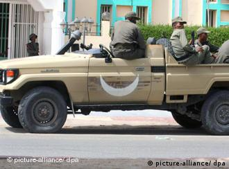 Mauritanian army soldiers keep watch from a vehicle