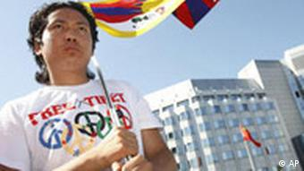 A protestor with a Tibetan flag in front of the Chinese embassy in Berlin