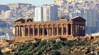 FILE - The ancient Greek Temple of Juno in Agrigento, Sicily, seen in this 1997 file photo, is one of the ten cultural and natural gems proposed by Italy, which won entry on UNESCO's World Heritage list during the U.N. agency's conference in Naples Thursday December 4, 1997. All ten Italian sites won entry amoung which the ruins in Pompeii, the Amalfi coast, the Greek mosaics near Enna, Sicily, making them eligible for UNESCO funding for restoration and improved security. (AP Photo/Alessandro Fucarini/File)